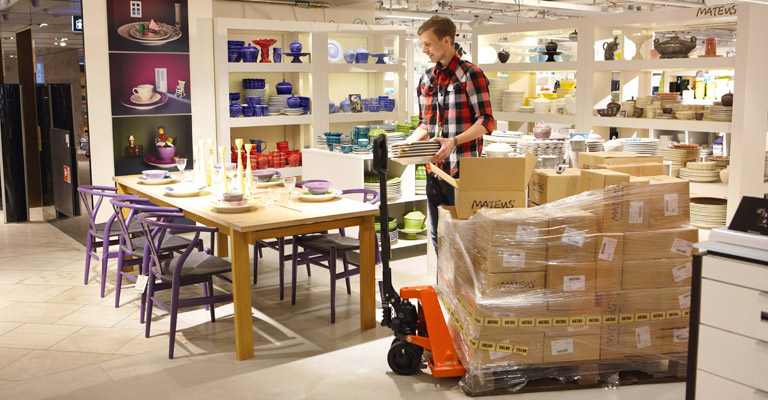 A hand pallet truck being used in a store